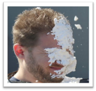 Pie in manager's face