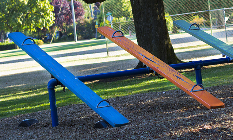 Image of a playground see-saw.