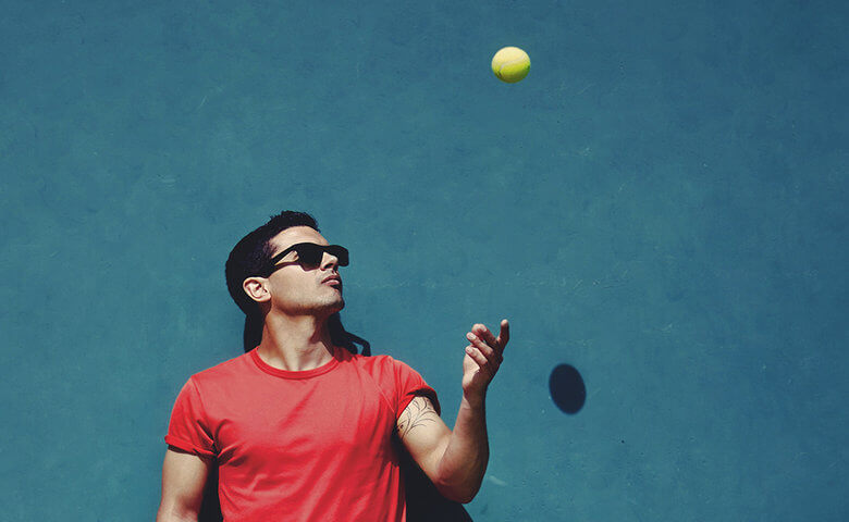 Man juggling a tennis ball