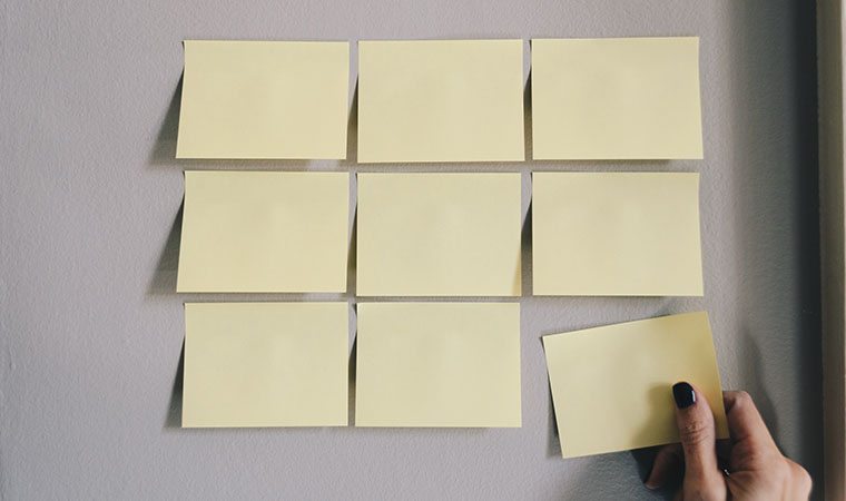 Sticky notes arranged on a wall.