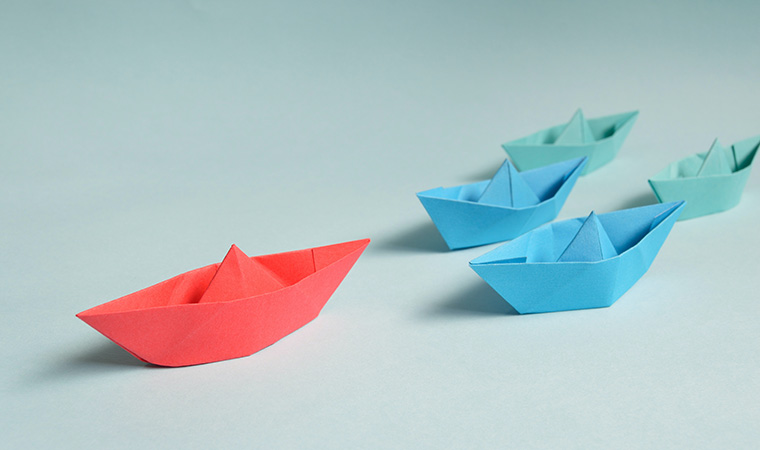 Paper boats on hard surface.